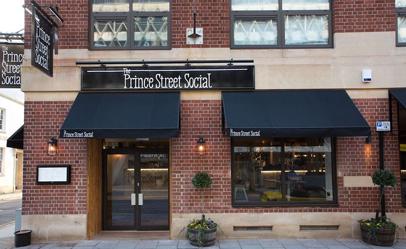Front window and signs of Prince Street Social