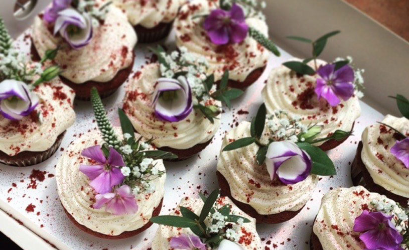 Beautiful cupcakes decorated with purple and white flowers by Ahh Toots, Bristol
