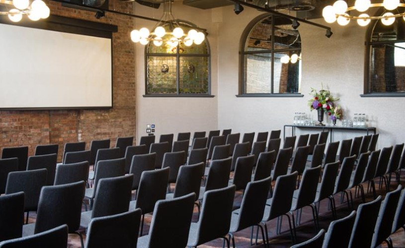 Seats and screen set up in event space at Avon Gorge by Hotel du Vin