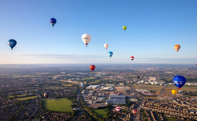 Hot air balloons flying over Bristol for the 2019 Balloon Fiesta press launch