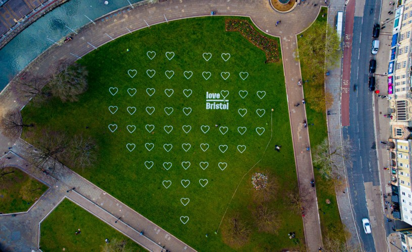 Aerial view of white hearts painted on Bristol's College Green