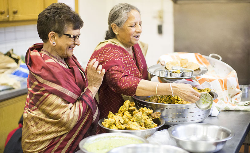 Two ladies cooking - British Dal Festival