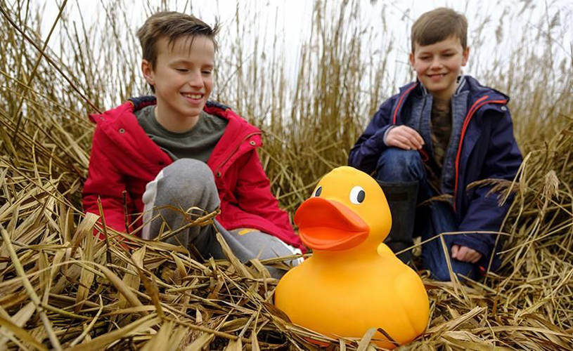 Kids with yellow rubber duck on Easter quest at WWT Slimbridge
