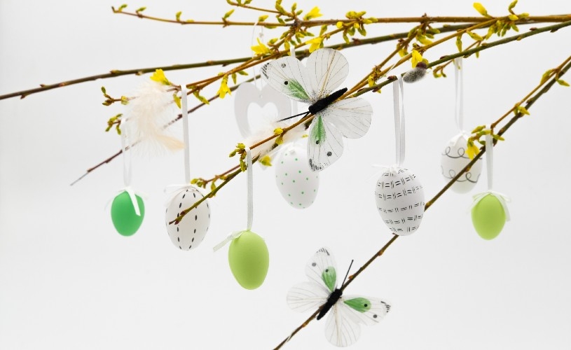 Butterfly and Easter egg decorations hanging on a tree
