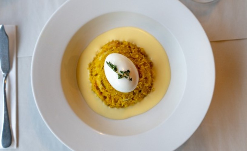 Fishers kedgeree and lemon butter sauce served in a white dish
