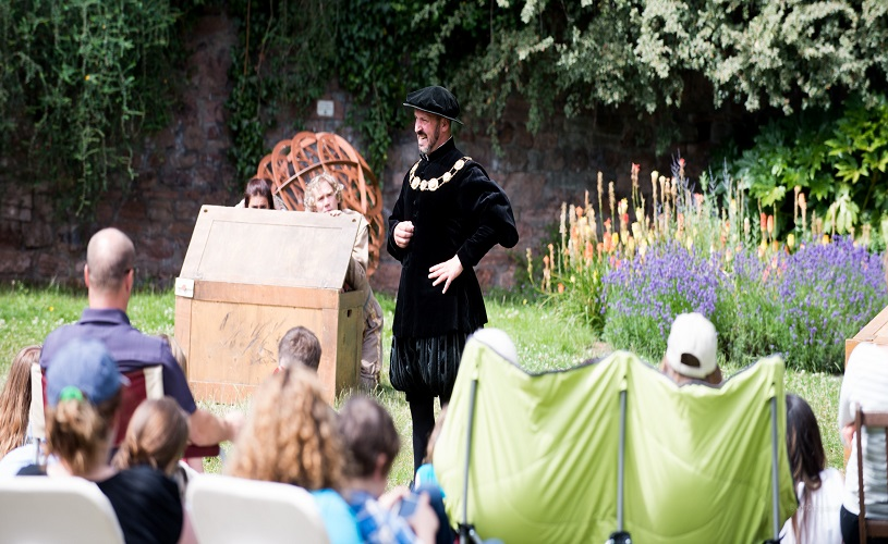 Actor performing outdoors in GB Theatre's Twelfth Night