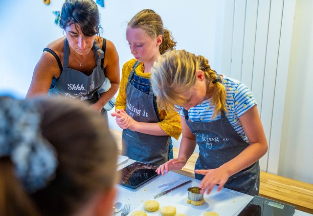 Monica Worsley teaching kids to cook at cookery school Cooking It