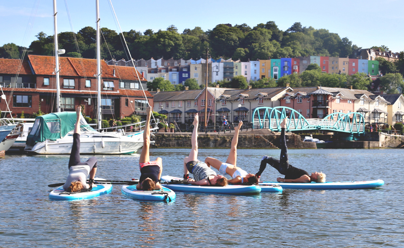 People doing SUP yoga in Bristol
