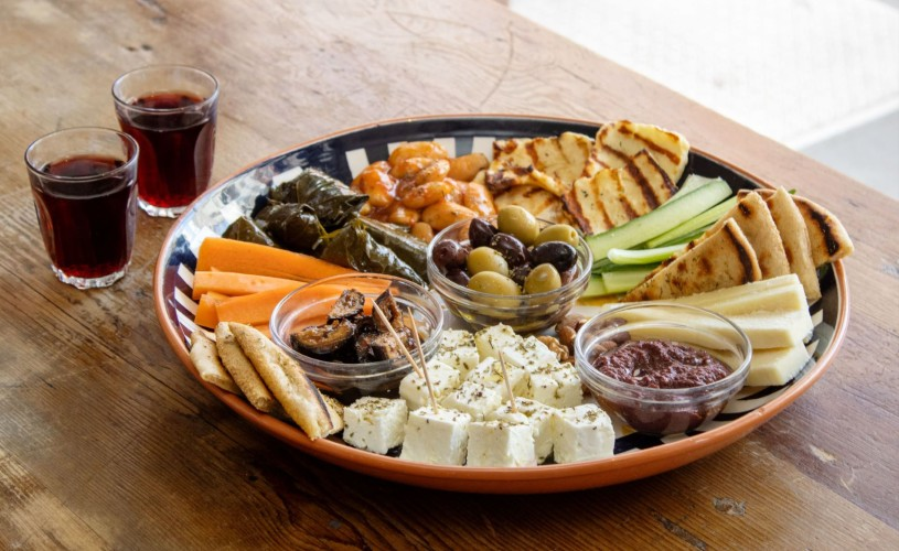 Plate of Greek food - olives, feta, pitta, halloumi and more - from The Real Greek marketplace