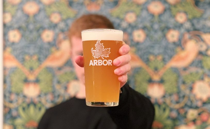 Man holding Arbor Ales beer in Strawberry Thief bar in Bristol