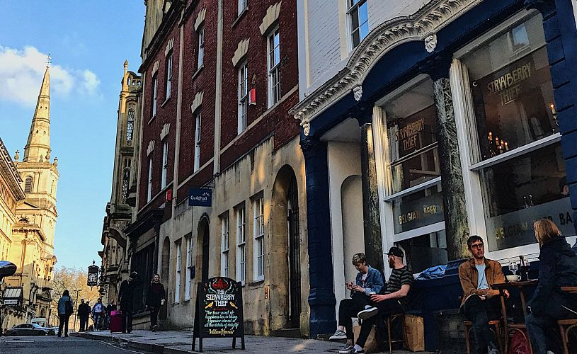 Strawberry Thief bar in Old City Bristol with beer drinkers sitting outside