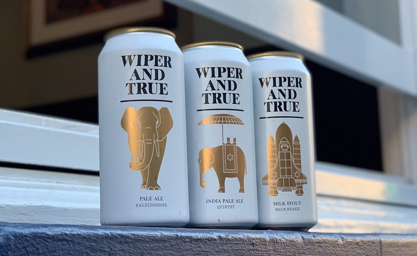 Cans of Wiper and True beers in the window of Strawberry Thief bar in Bristol