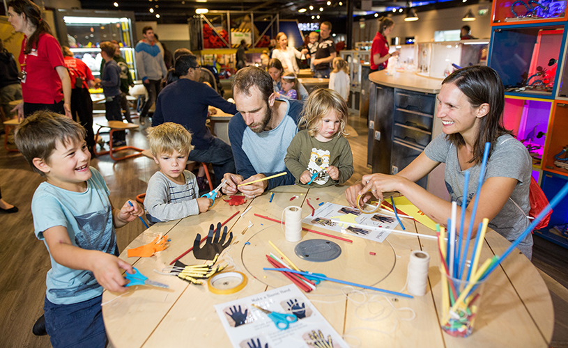 Family making bionic hands at We The Curious