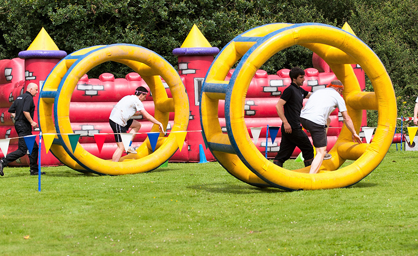 People in inflatable wonder wheels at ACF Teambuilding event