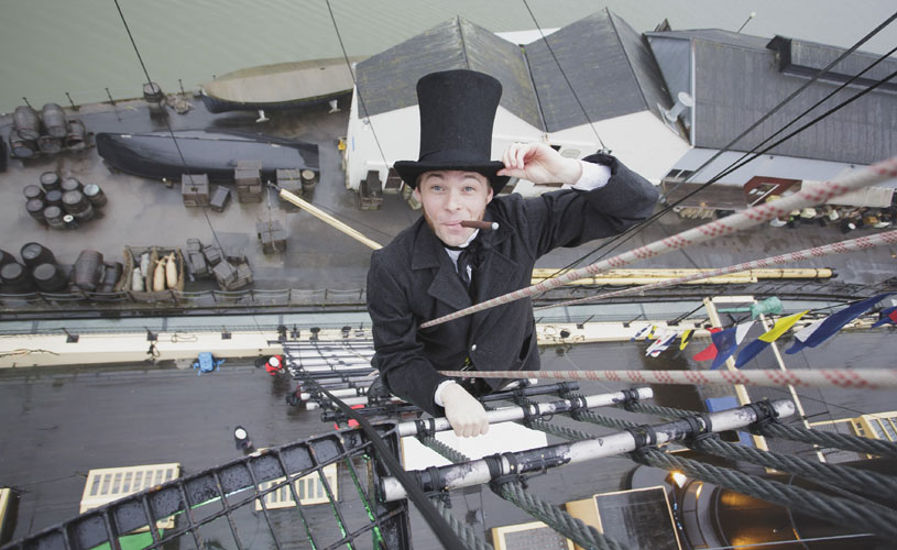 Mr Brunel climbing the rigging on SS Great Britain as part of the Go Aloft experience