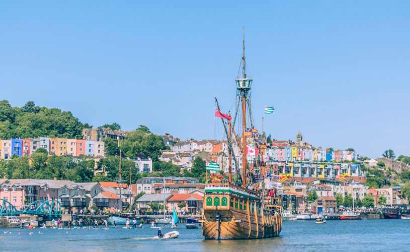 The Matthew sailing past the colourful houses of Clifton Wood in Bristol