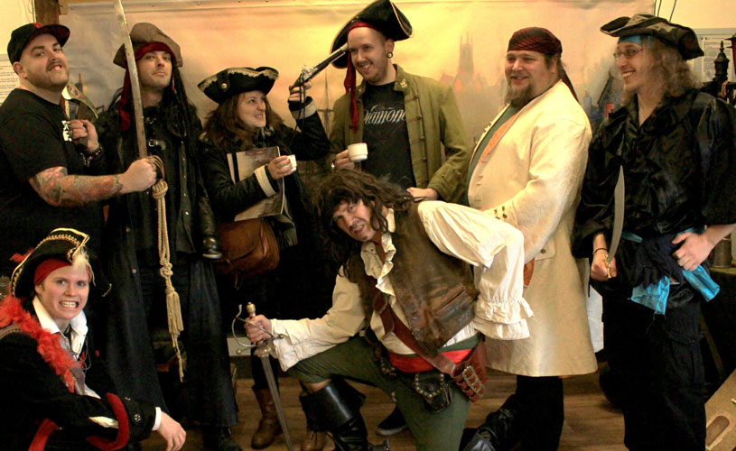 A group dress up as pirates for a walking tour with Pirate Pete