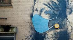 Banksy: The Girl with the Pierced Eardrum Coronavirus mask Photograph: Rogan/JMP/Rex/Shutterstock