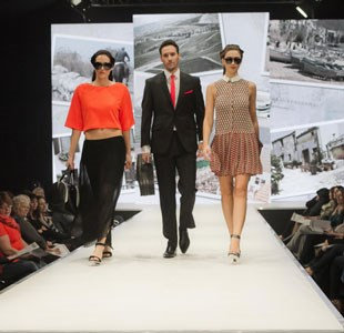 Three catwalk models walking down the runway at Bristol Fashion Week