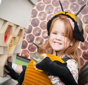 Girl dressed as a bee enjoying At-Bristol