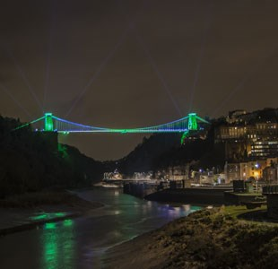 Clifton Suspension Bridge lit up in green lights