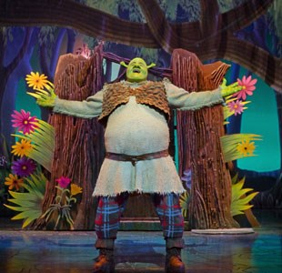 Shrek on stage performing in the musical