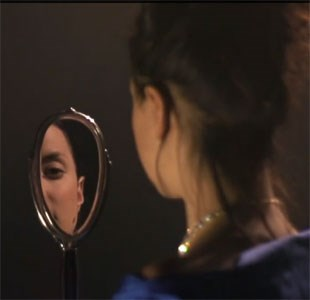 Estella looking in a mirror in Great Expectations