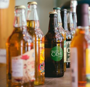 Cider bottles lined up on Bristol Cider Shop counter