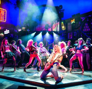Performers on stage for Rock of Ages