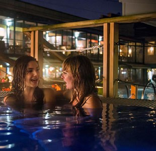 Two women chatting in the hot tub at The Lido