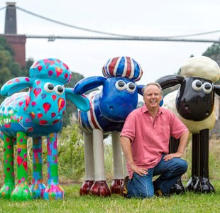 Nick Park with painted Shaun the Sheep statues