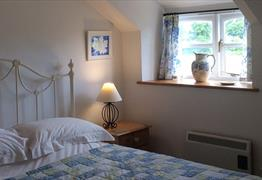 Bedroom in The Tallett holiday apartment at Woodbarn Farm Cottages