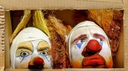Two clowns trapped in a cardboard world